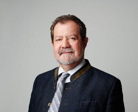 Dipl.-Ing. Hans-Joerg Gasser with tie, CEO