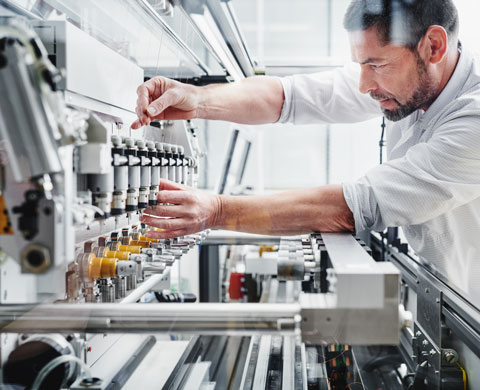 Employee during machine production